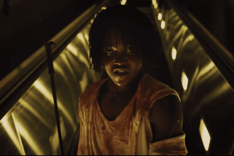 Adelaide Wilson goes down into the tunnels to face Red (both played by Lupita Nyong'o)