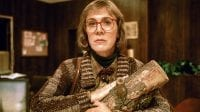 The Log Lady holds her log