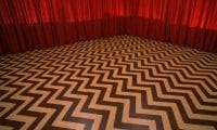 chevron floor and red drapes in the black lodge