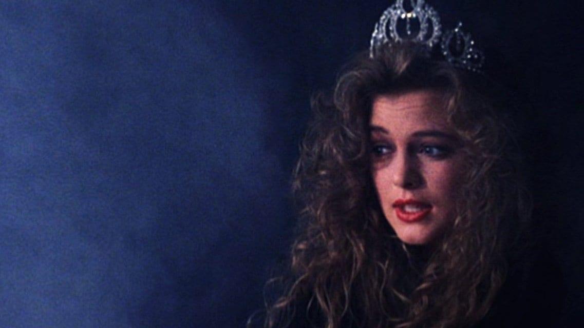 Annie Blackburn wearing the Miss Twin Peaks crown in a dark smokey space