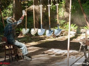 Dr Jacoby sprays 5 shovels with gold paint