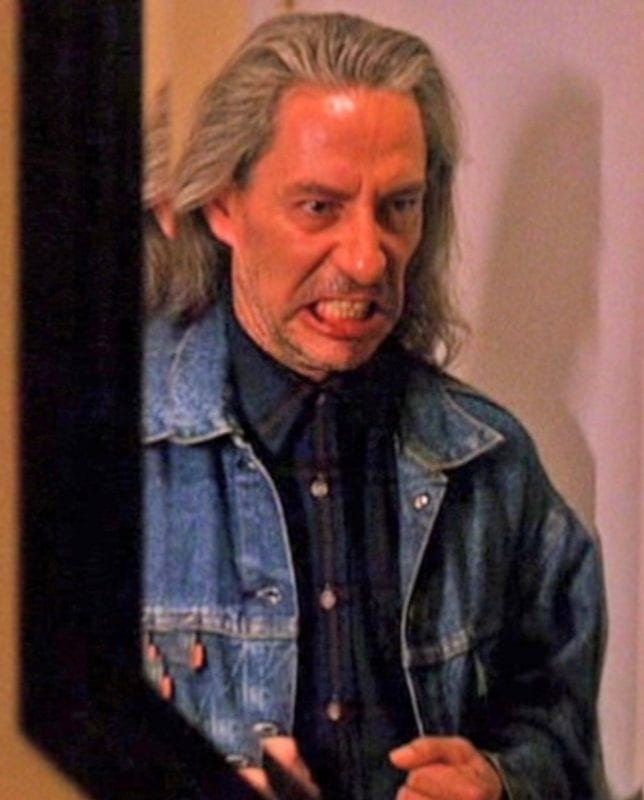BOB snarls at his reflection in a mirror in Twin Peaks