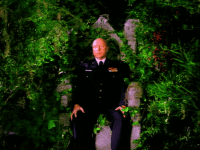 Major Briggs vision of himself sitting on a throne covered in greenery