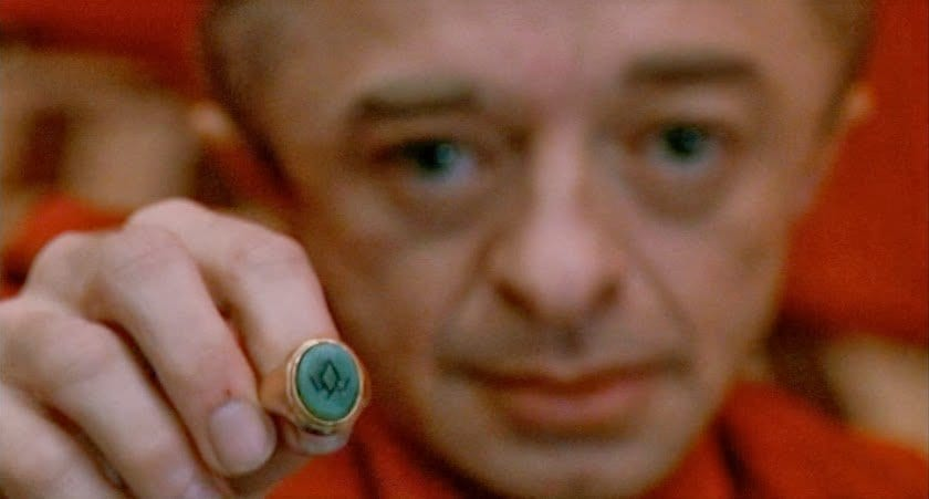 The owl cave ring shown to the audience by the little man from another place