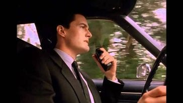Dale Cooper talking into a dictaphone while driving