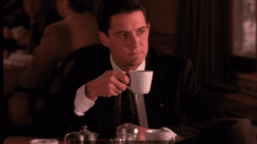 Dale Cooper drinking coffee at the great northern hotel