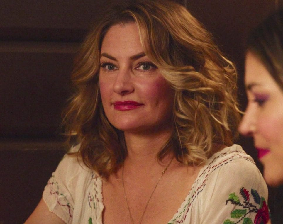 Shelly Johnson sits at the Roadhouse smiling