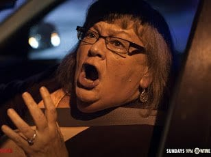 woman shouting in her car