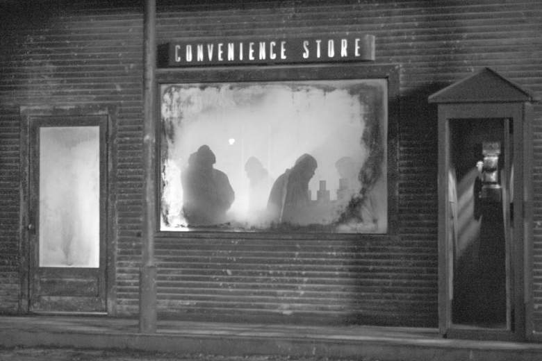 The Convenience Store window lit with woodsmen silhouetted