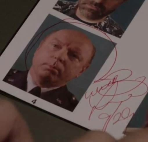 Bill Hastings signs a photo of Major Briggs to show that he saw him in The Zone