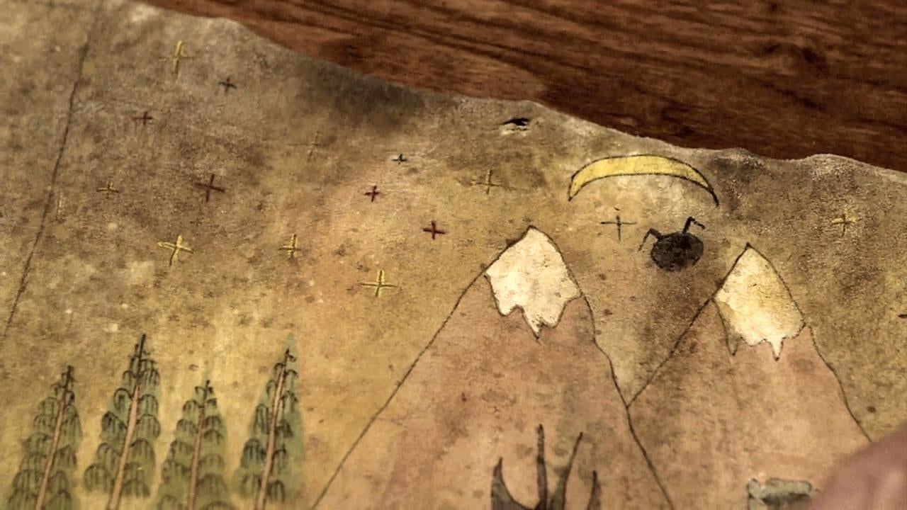 a crescent moon, a black shape, two mountains and fir trees painted on a map