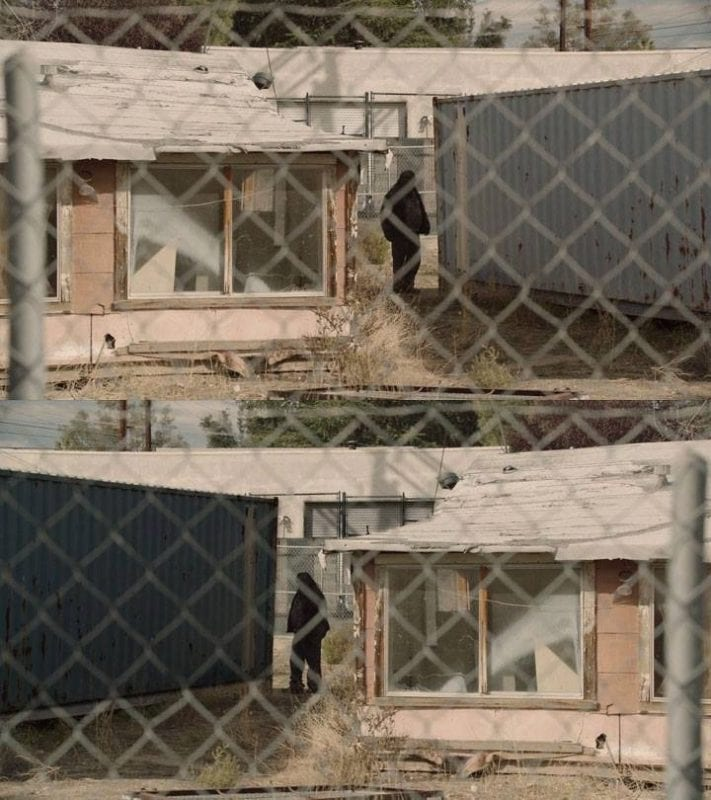 a dark figure stands between a storage unit and a pink bungalow. 2 of the same image flipped