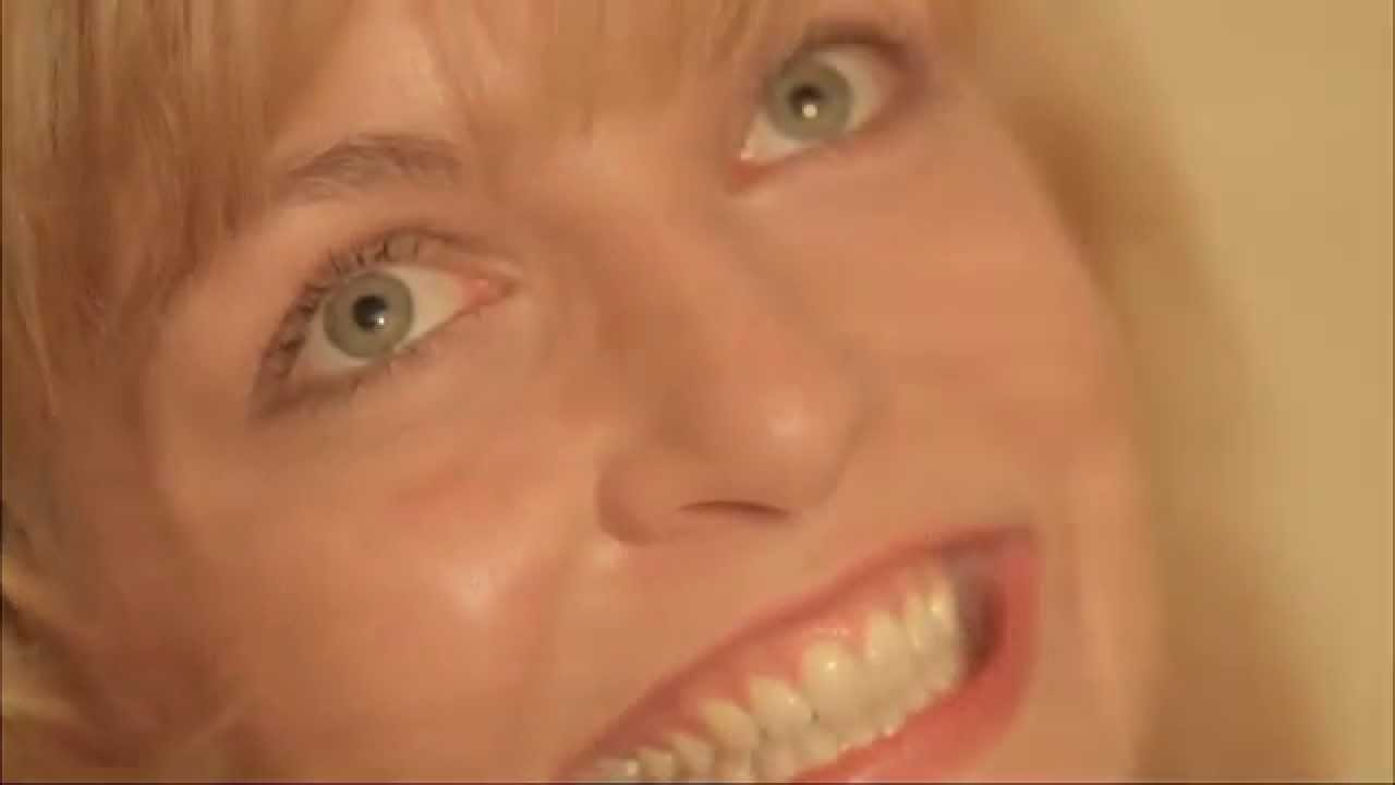 Laura Palmer grins and looks up at the ceiling fan