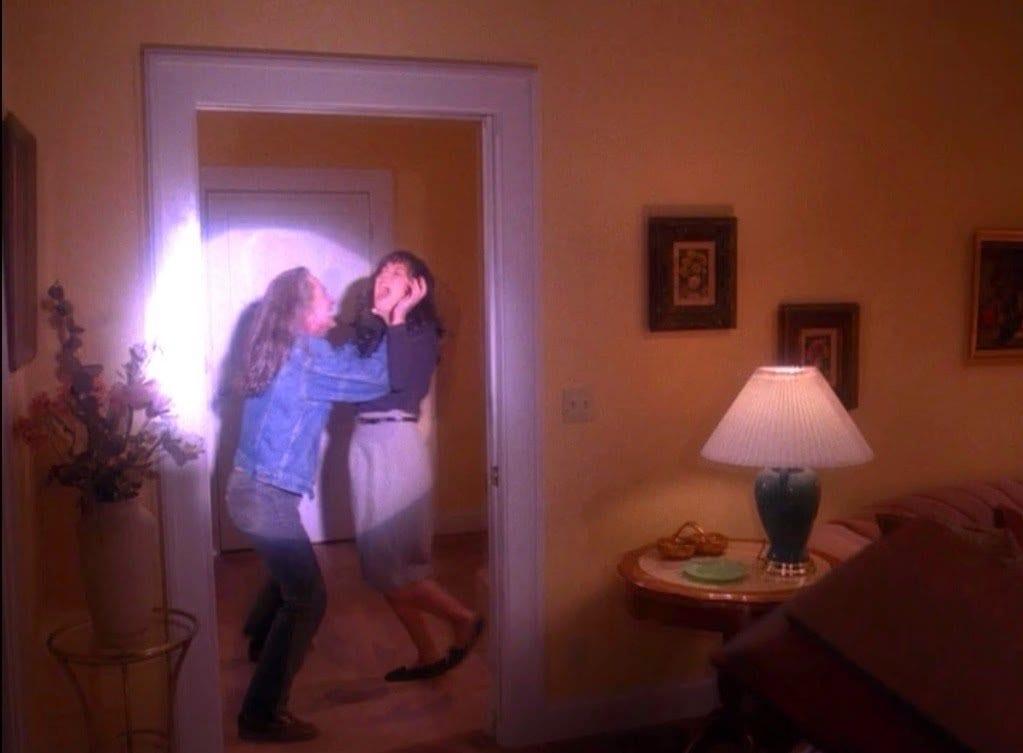 Bob grabs Maddy in a spotlight
