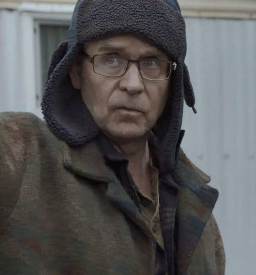 Cyril Pons played by Mark Frost wearing a deerstalker hat