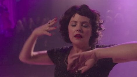 Audrey Horne dancing in purple light