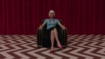Diane sits in a chair in the red room