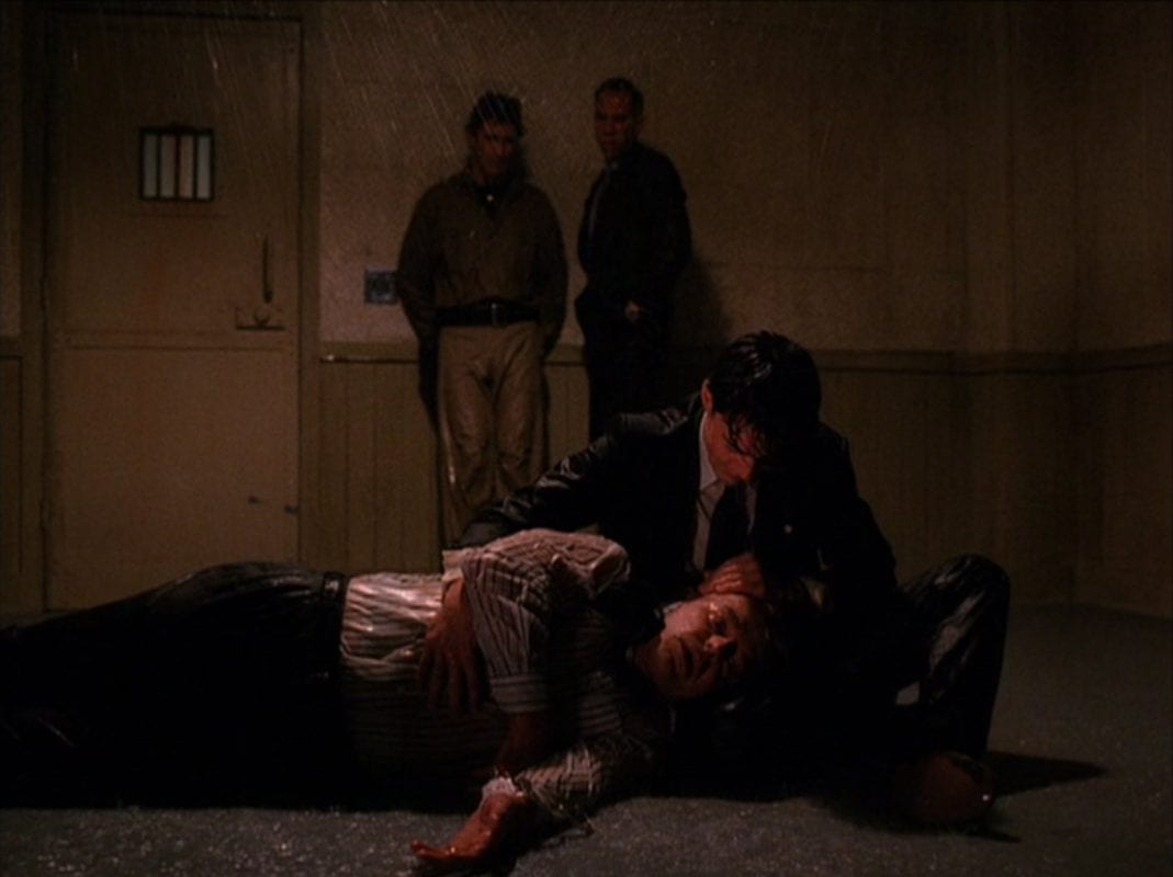 Cooper holds Leland as he dies from his head injuries at the sheriffs station