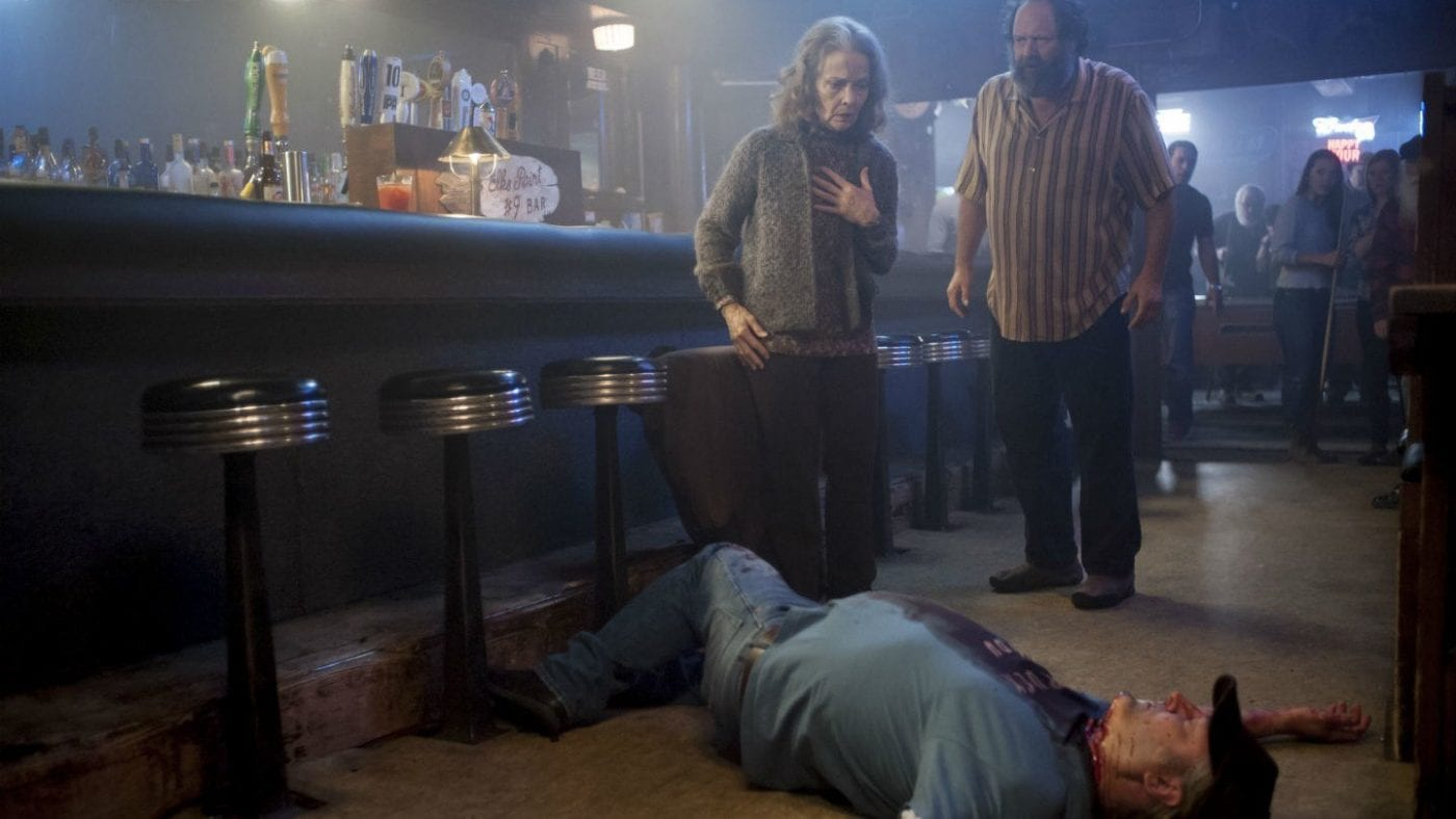 Sarah Palmer and the Elks bar owner look horrified at the body of a trucker lying on the floor with his throat slashed