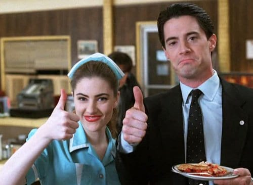 Shelly and Cooper with their thumbs up and a plate of cherry pie in the RR Diner
