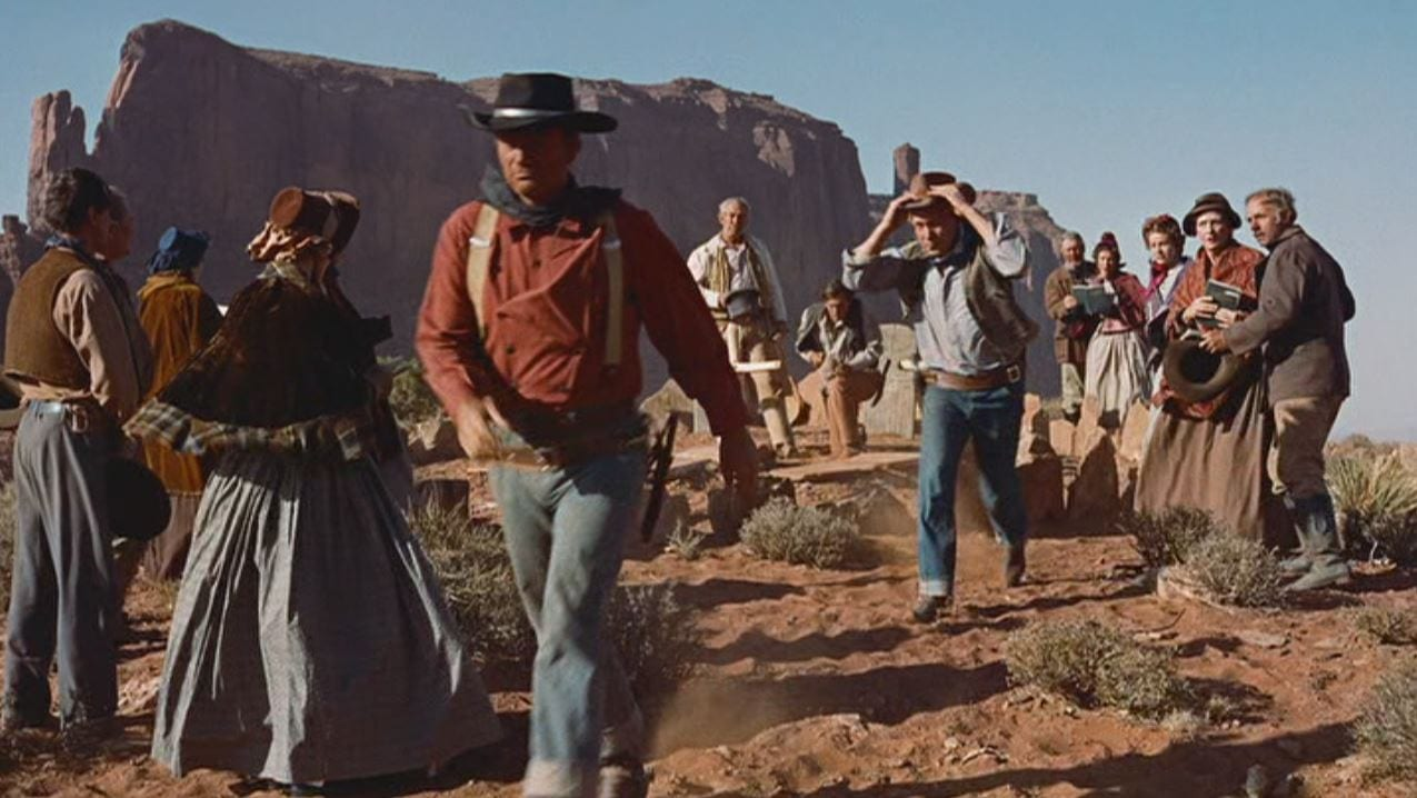 Funeral scene of a Western film with cowboys