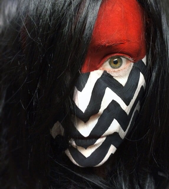 Gisela with her face painted like the black lodge