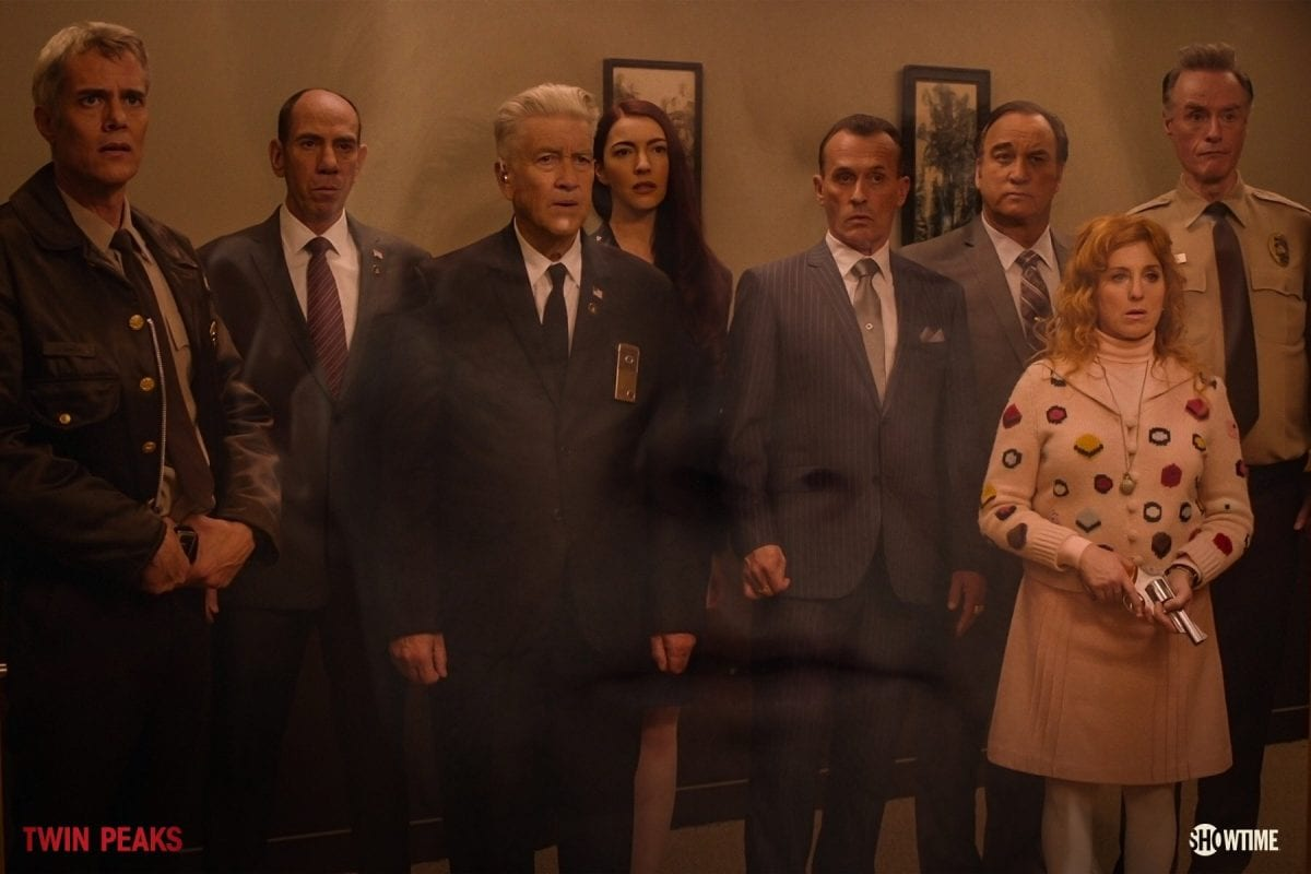 Bobby, Albert, Gordon, Tammy, Mitchum Brothers, Lucy and Andy all stand at the Sheriffs station. Coopers face superimposed over the image