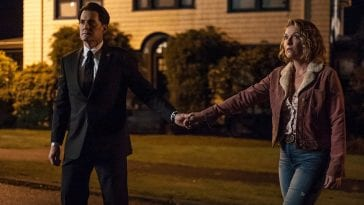 Dale Cooper and Carrie Page hold hands and walk towards the palmer house