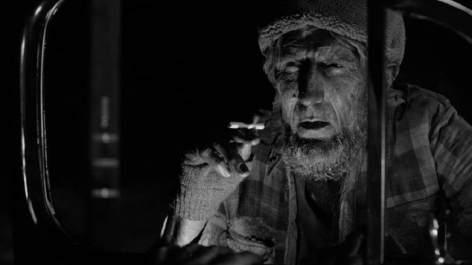 Woodsman peers through a car window to ask for a light for his cigarette