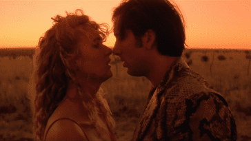 Sailor and lula embrace as the sun sets in wild at heart