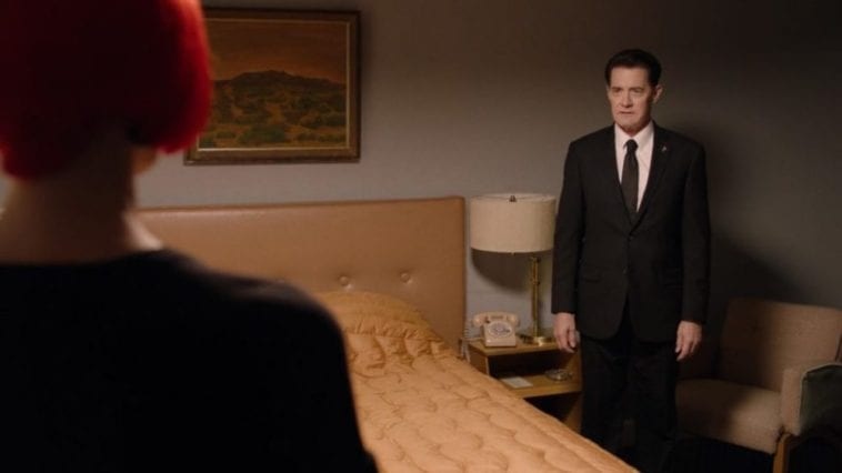Diane and Cooper acting awkwardly in a motel room