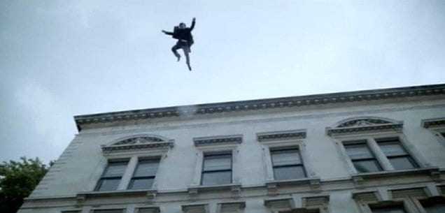 a man jumps off the top of a building