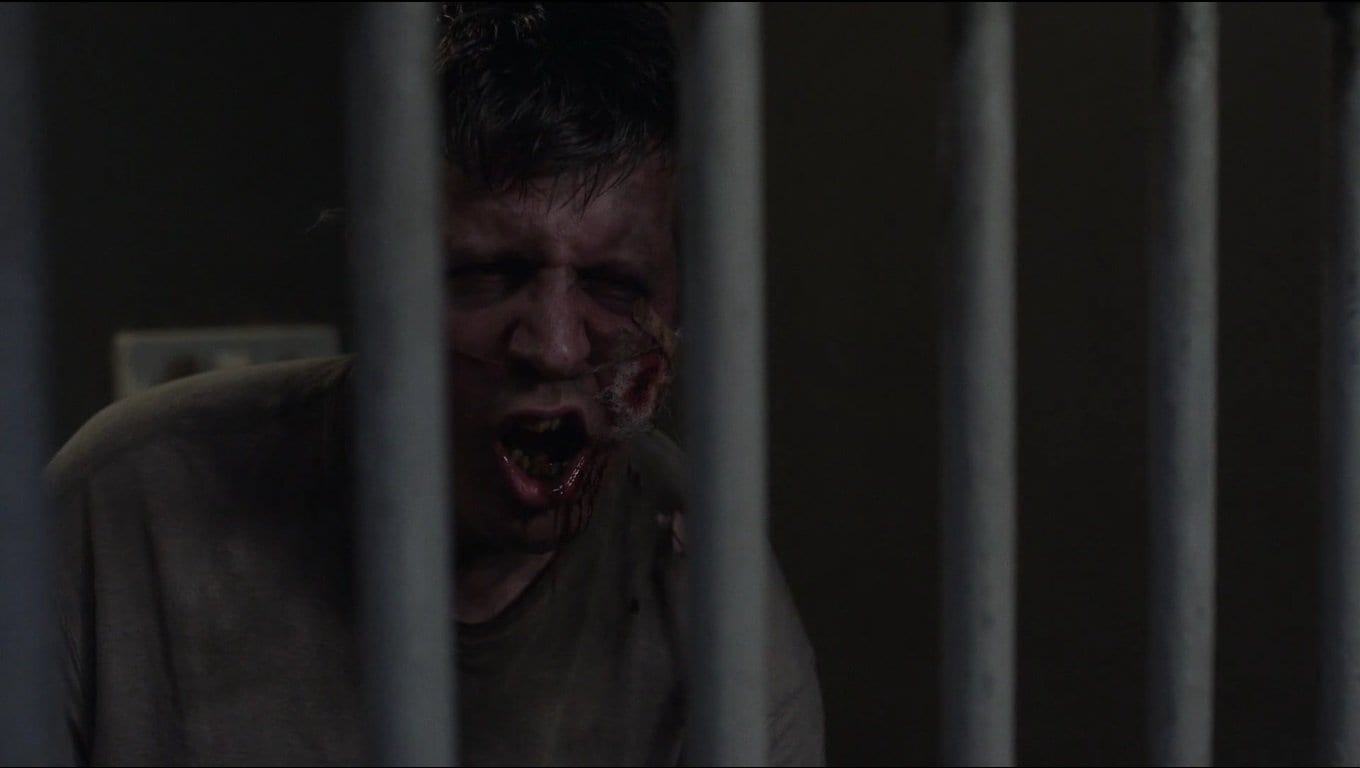 a drunk in a cell mimicking like a bird in Twin Peaks