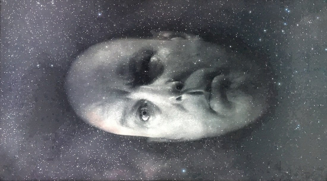 Major Briggs' head floats through space
