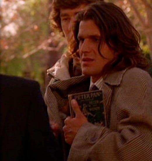Johnny Horne clutches a copy of Peter Pan at Laura Palmer's funeral