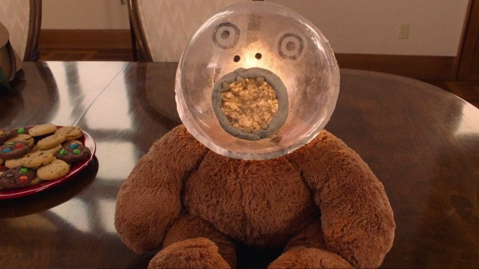 Johnny's teddy bear with a glass globe head, teeth and glowing light