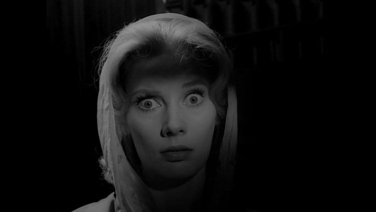 a blonde woman looks startled in Carnival of Souls