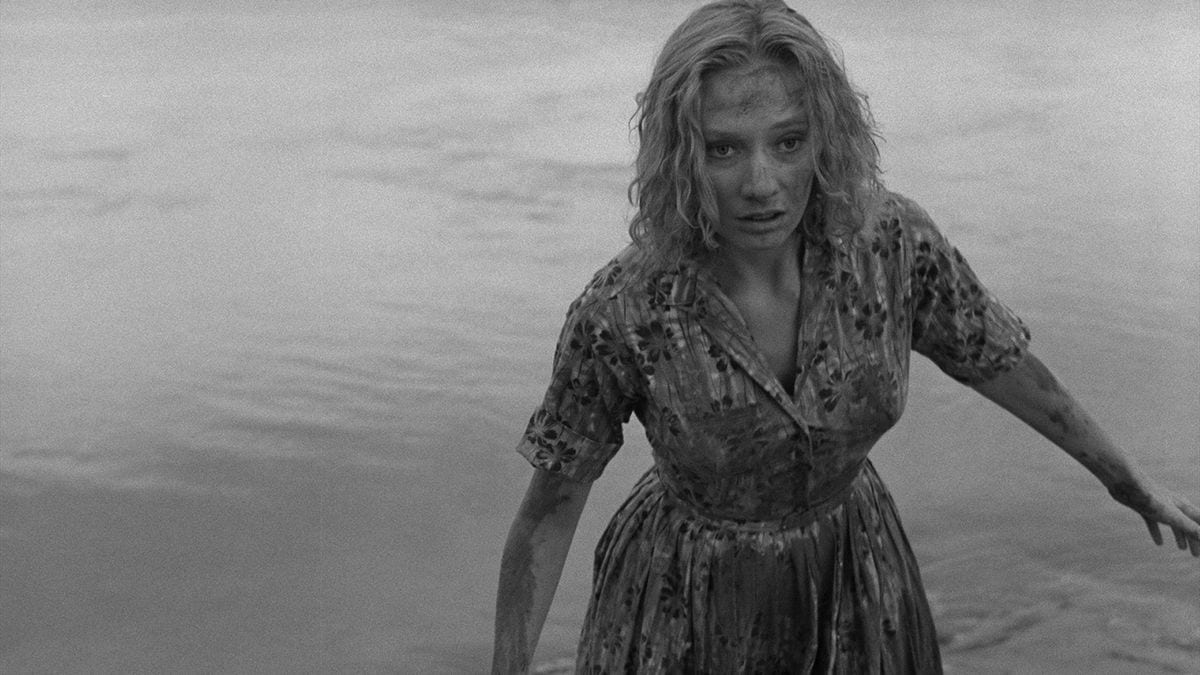 a woman drags herself out of the sea in Carnival of Souls