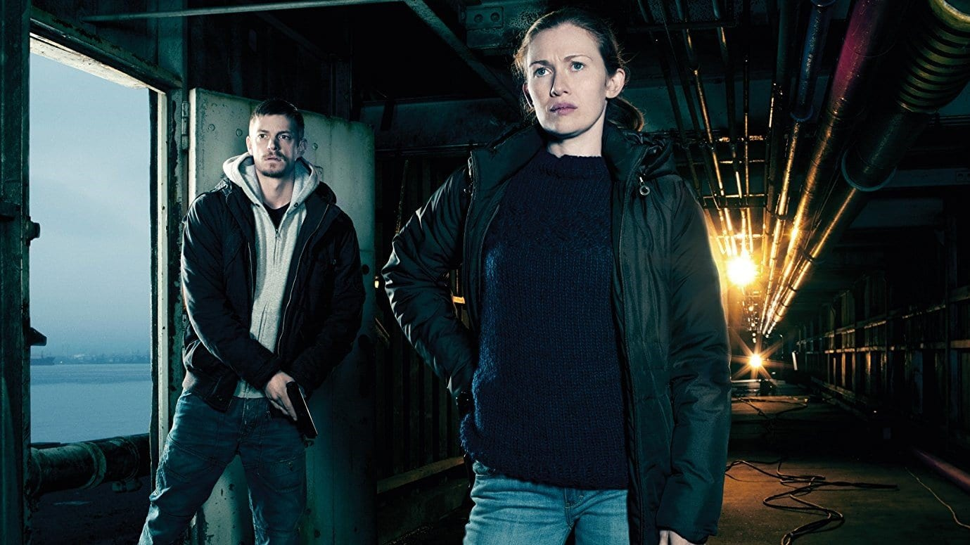Linden and Holder in the first season of The Killing barging into a warehouse investigating a murder