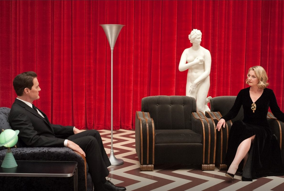 the black lodge with venus statue as cooper and laura sit in armchairs