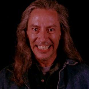 Bob grins and wears denim