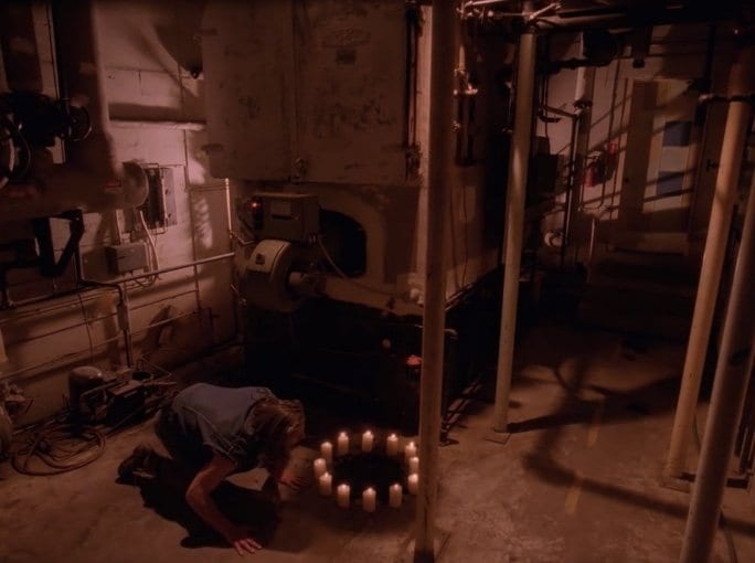 BOB in the hospital basement with a circle of candles burning