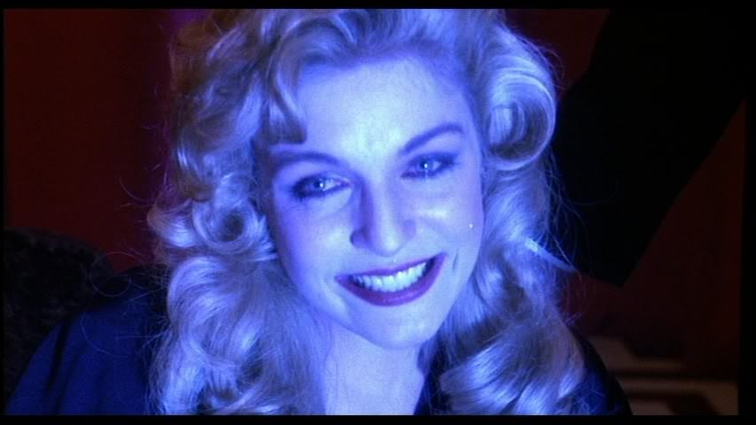 Laura Palmer in blue light smiling and crying