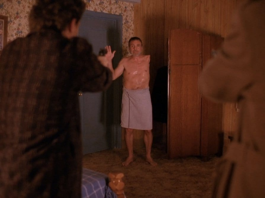 The one armed man raises his hand as Harry storms his room at Timber Falls Motel Twin Peaks