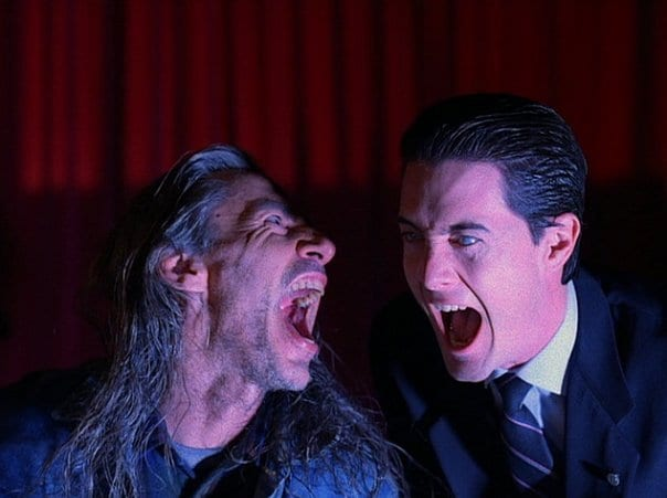 Bob and Coopers doppelganger laugh maniacally in the black lodge