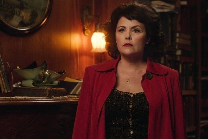 Audrey Horne wearing a burgundy jacket