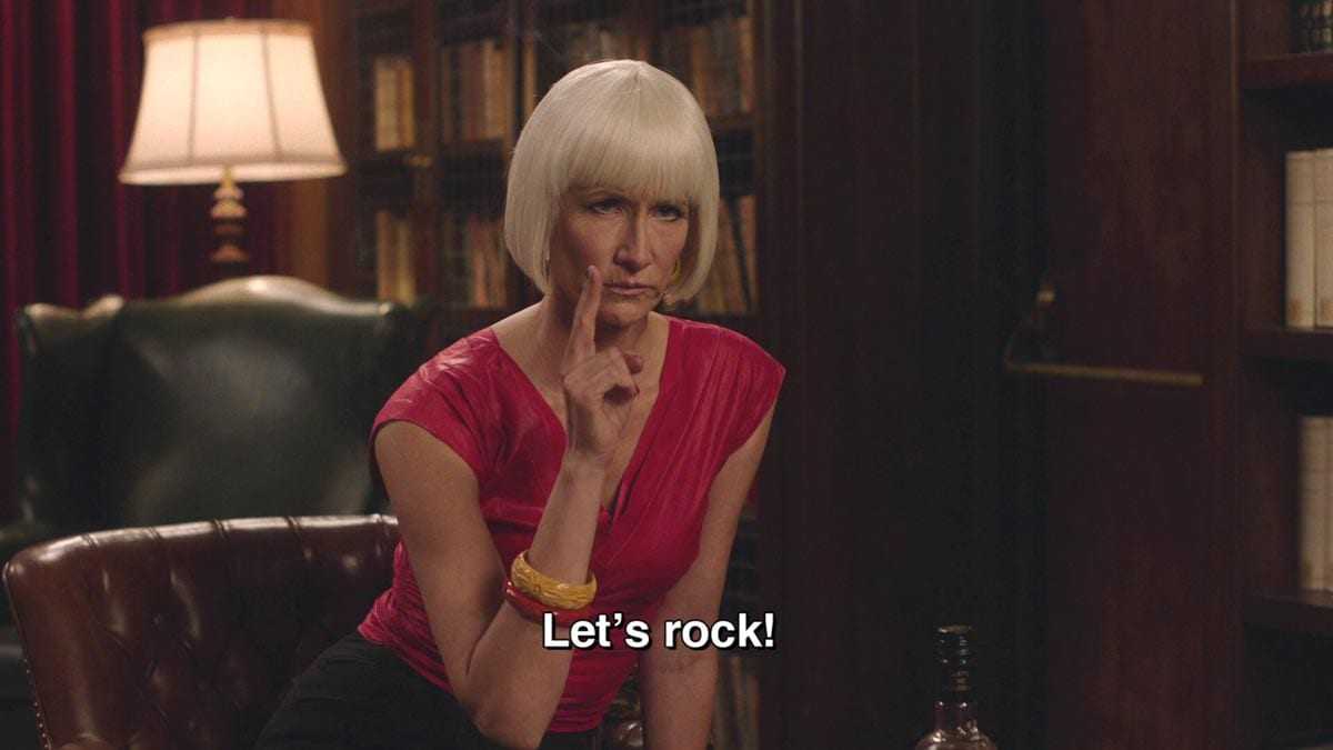 Diane raises two fingers to a gun and says Let's Rock