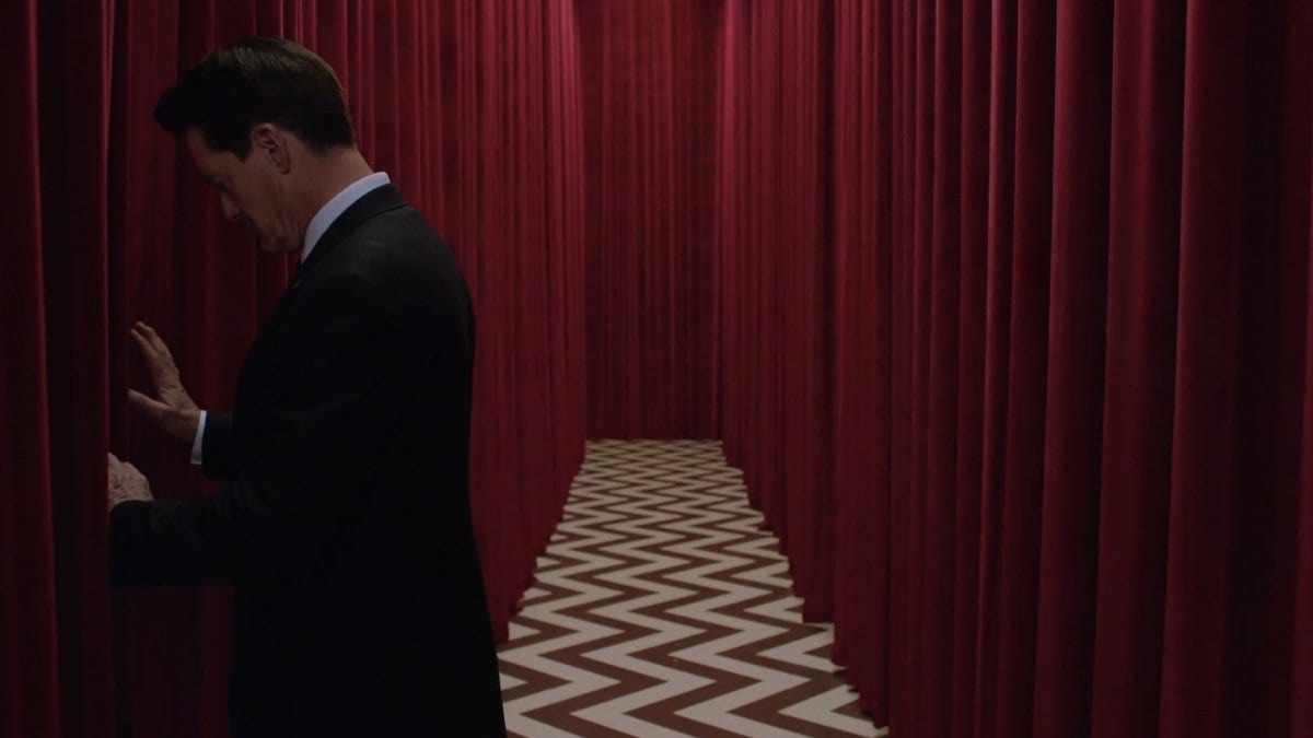 Cooper tries to open the curtains to a room in the black lodge