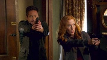 Mulder and Scully burst into a room with their guns raised