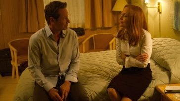 Mulder and Scully sit on a bed together